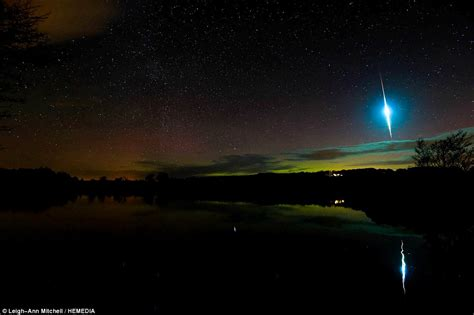 meteor shower lights blue blue flash streaks across the northern lights during