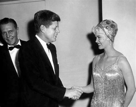 president kennedy chats with marilyn and other