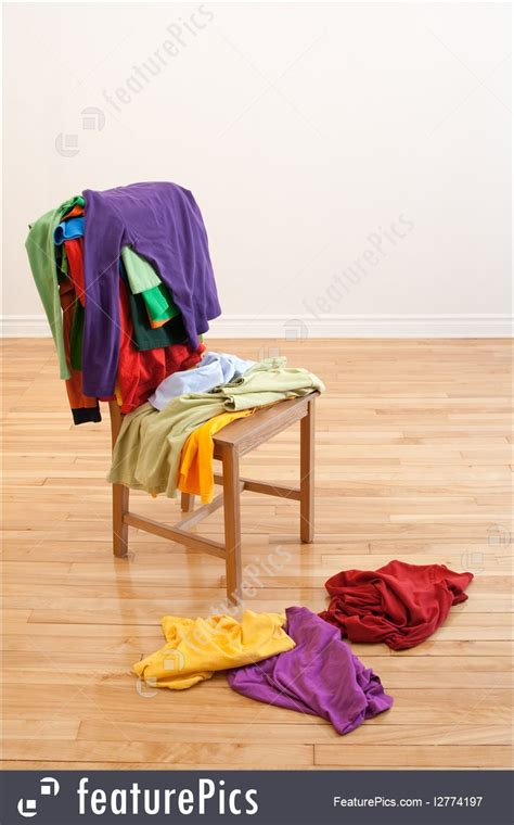 picture  colorful messy clothes   chair