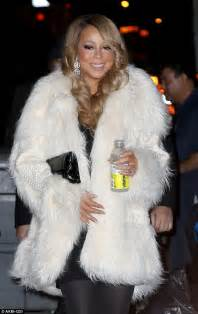 Careys Fur Coat Is Lost In The Mail by Carey Wears White Coat As She Heads To