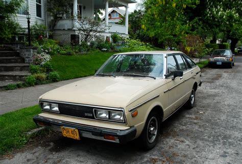 hatchback cars 1980s parked cars 1980 datsun 510 hatchback