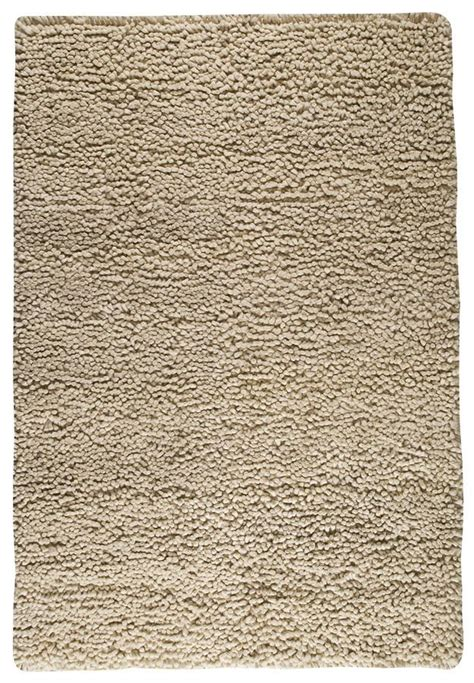 berber collection woven wool shag area rug in white