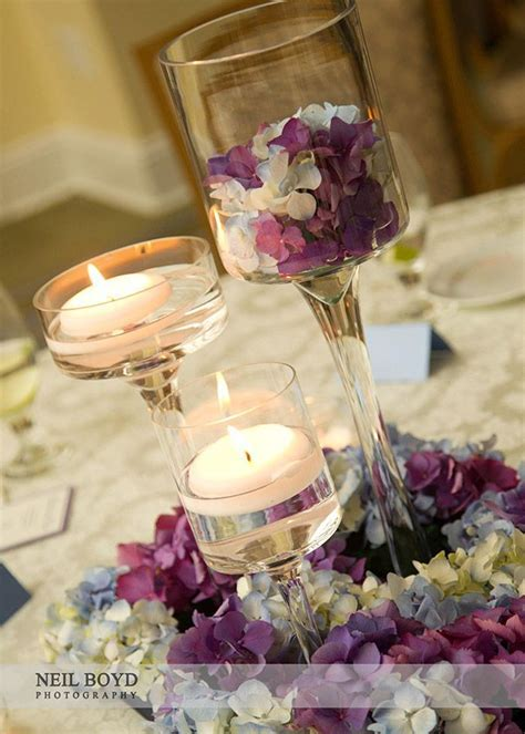 Floating candle centerpieces. Blue & purple hydrangea