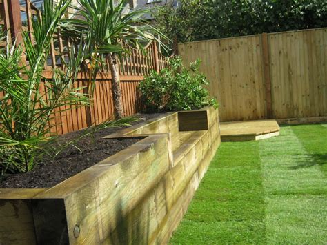 raised garden bed with bench seating railway sleepers 171 garden gurus landscape gardening in