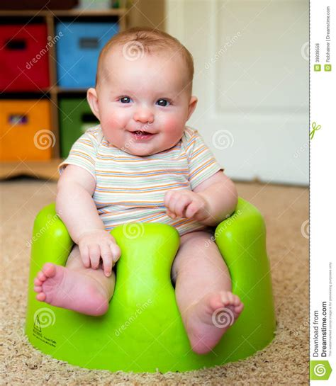 sit up chair for baby baby using bumbo seat to sit up stock photo