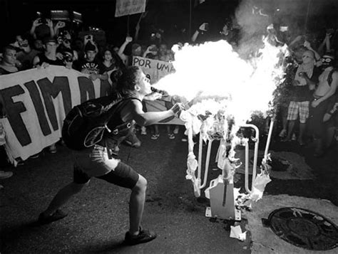 Jersey Wigan Away 1112 Match Issue a spits flammable liquid on a turnstile set on the in protest against increased