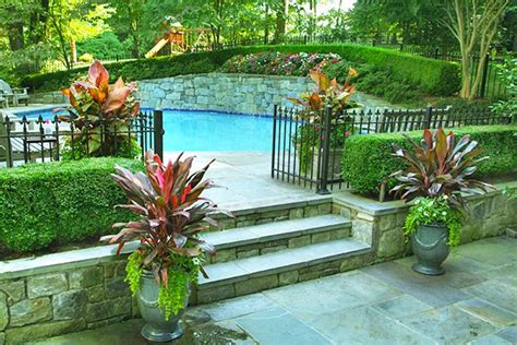 sloping backyard ideas how to build a pool what to do with a sloped backyard