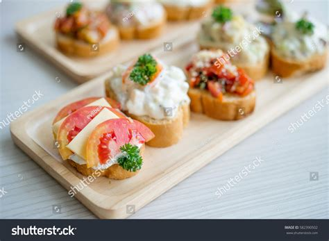 toast canapes mix canapes toast tomato cheese on stock photo 582390502