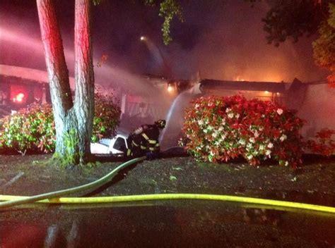 Fire destroys Bellevue auto showroom, dozens of cars   The