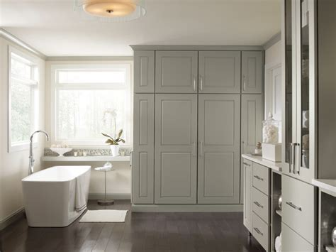 bathroom with floor to ceiling cabinets and a console