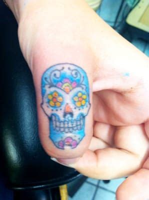 finger tattoo reviews sugar skull finger tattoo done by neil wilson yelp