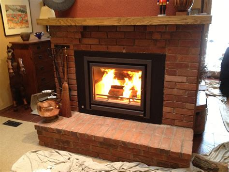 Putting Wood Stove In Fireplace by Installing Wood Stove In Currently Existing Wood Burning