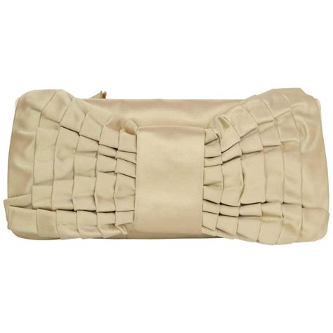 Other Designers Sang A Pleated Python Evening Clutch by Valentino Chagne Silk Pleated Bow Clutch For Sale At