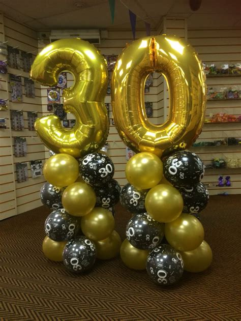 themes in black balloon 30th super shape numbers in gold with black and gold latex