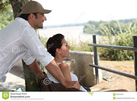 couple sitting on bench couple sitting on a bench royalty free stock images