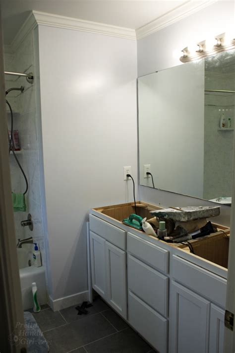 how to hang a frameless bathroom mirror how to hang a frameless oval mirror pretty handy girl