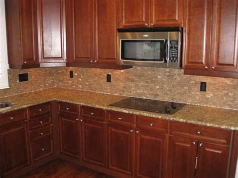 tile backsplash with cherry cabinets for the home