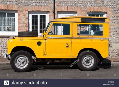 land rover yellow yellow land rover defender four wheel drive vehicle stock