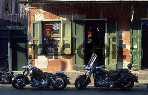 Harley Davidson New Orleans Quarter by Harley Davidson Motorcycles In Front Of A Pub At