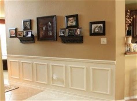 faux raised panel wainscoting achieved with chair rail base and applied rectangular frames on