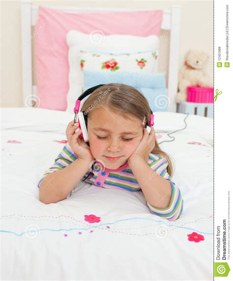 free music beds little gril listening to music lying on her bed royalty free stock photos image