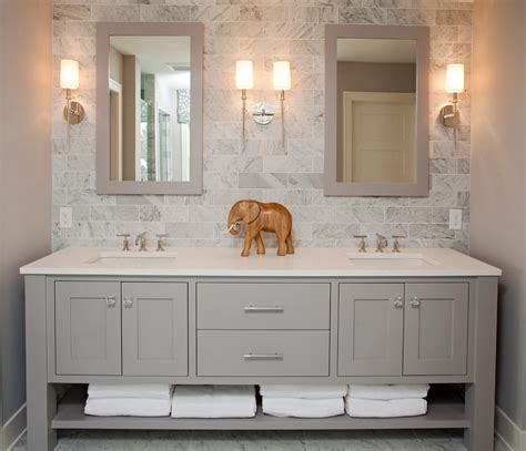 Bianco statuario countertop bathroom beach style with subway tile backsplash wooden linen towers