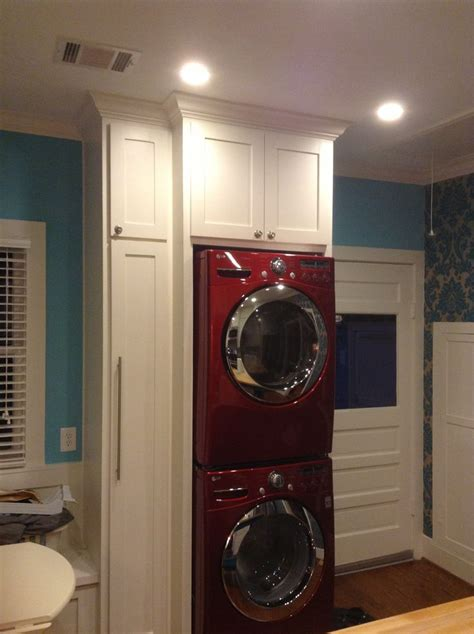 red lg stacked washerdryer laundry area  kitchen