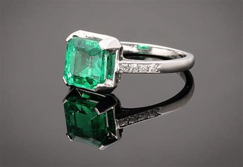 square cushion cut vintage engagement ring with emerald