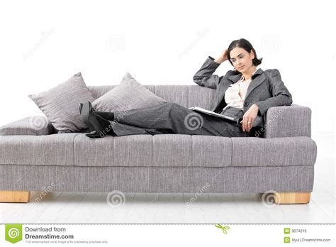 sitting in sofa businesswoman sitting in sofa royalty free stock image