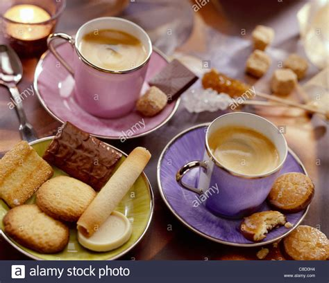 Buy Coffee Cups caf 233 atmosphere with cups of coffee and petit four