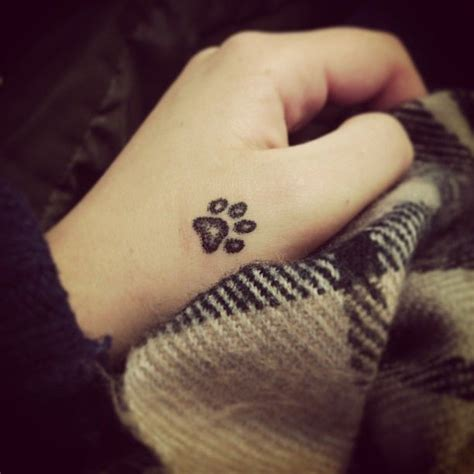 super cute dog paw hand tattoo design cool tattoo