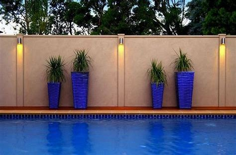 smart fence swimming pool privacy fence  smart fence lighting  blue accent  cement
