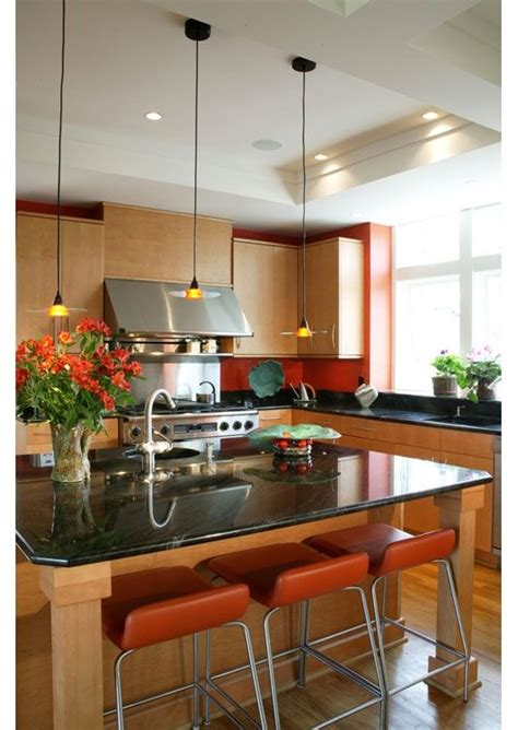burnt orange looks with these maple cabinets and