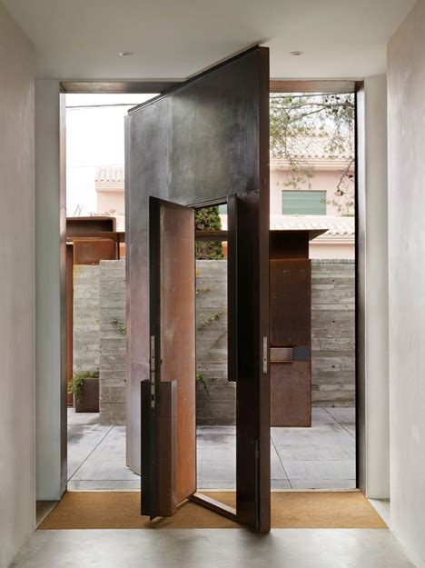 Pivoting Front Door Pivoting Steel Doors Lead Into A House And Photography Studio By Kundig Architecture