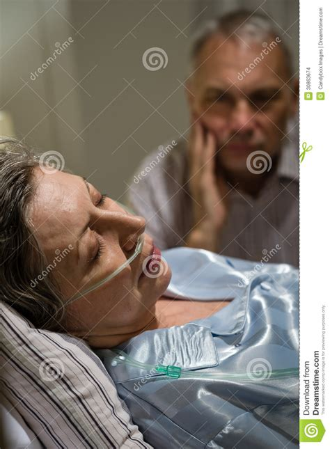 dying in bed with caring stock images image