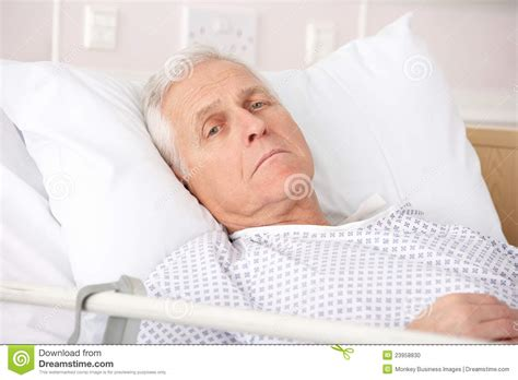 what to do in bed senior man ill in hospital bed stock photo image of
