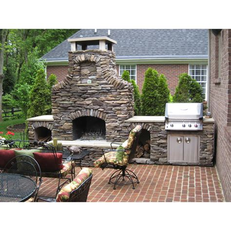 a custom outdoor fireplace by select family leisure