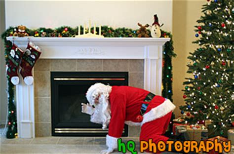 santa by fireplace photo