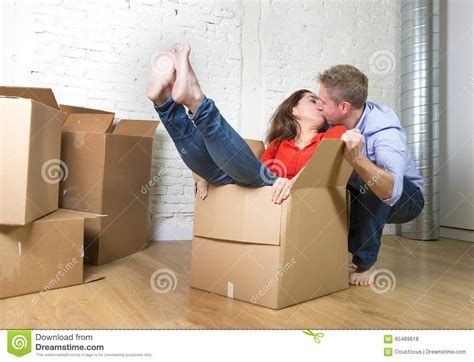 how to put a box together happy american couple unpacking moving in new house
