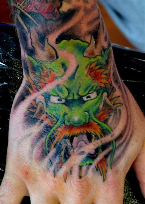 tattoo dragon on hand dragon hand tattoo by chris garver tattoos pinterest