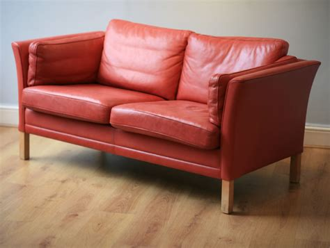 two and three seat sofa soft leather and coral colour