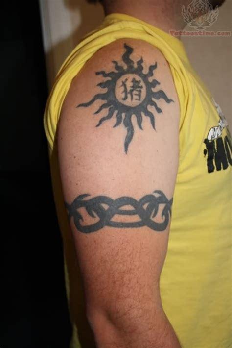 tribal sun and armband tattoos for guys real photo