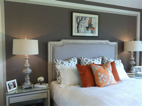 Orange Master Bedroom Decorating Ideas by The Grey Paint White Quilt Orange Accents Master