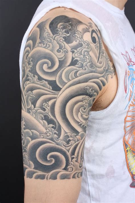 oriental tattoo clouds black and grey japanese cloud tattoo on right half sleeve