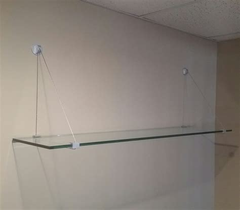 custom glass shelves and brackets by floyd
