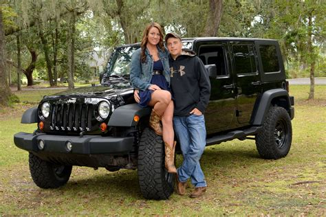 jeep couple nice picture of a lovely couple with their jeep car