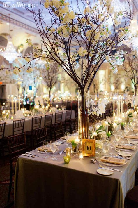 Enchanted gold and green wedding centrepieces, flowers