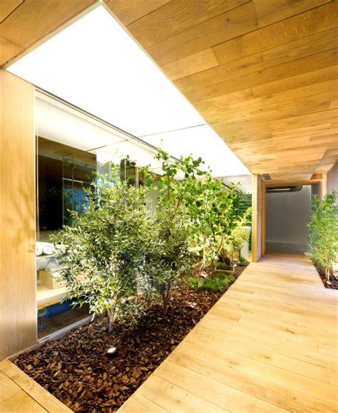 garden inside house industrial loft space with fresh green decor interiorzine