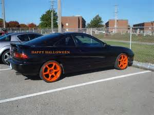 black car orange rims black