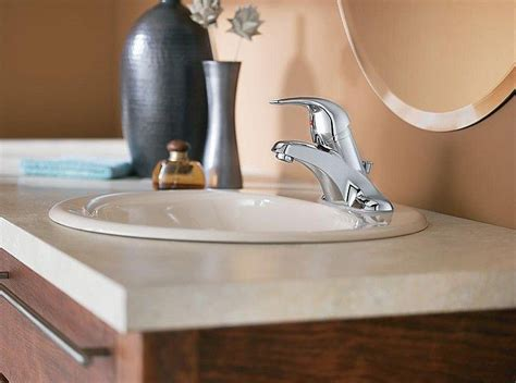 how to install a bathroom sink faucet installing a new bathroom faucet in a new vanity top